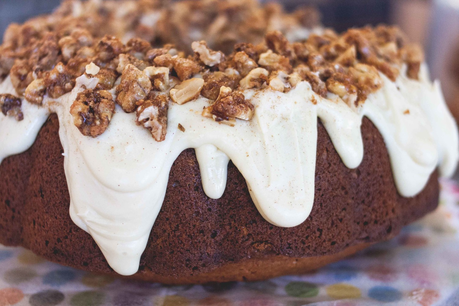 Butternut squash spice cake with white chocolate + maple ganache topped w/ candied maple walnuts