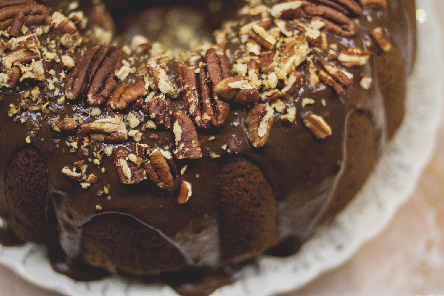 Whole grain pumpkin spice cake with dark chocolate chunks + toasted pecans topped with dark chocolate & coconut ganache