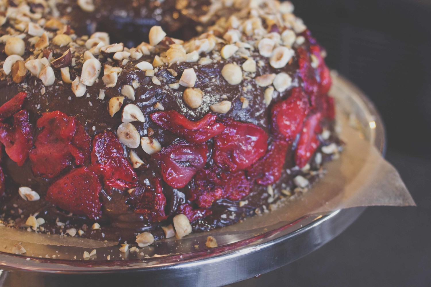 Roasted hazelnut + dark chocolate bourbon cake with sea salt roasted strawberries and dark choc ganache